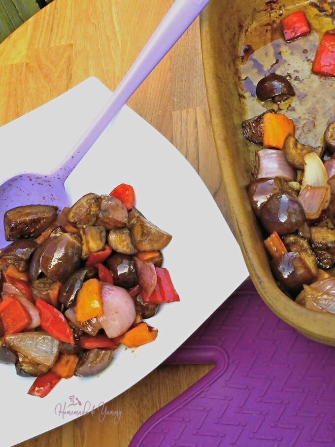 Eggplant Medley getting scooped into a serving bowl.
