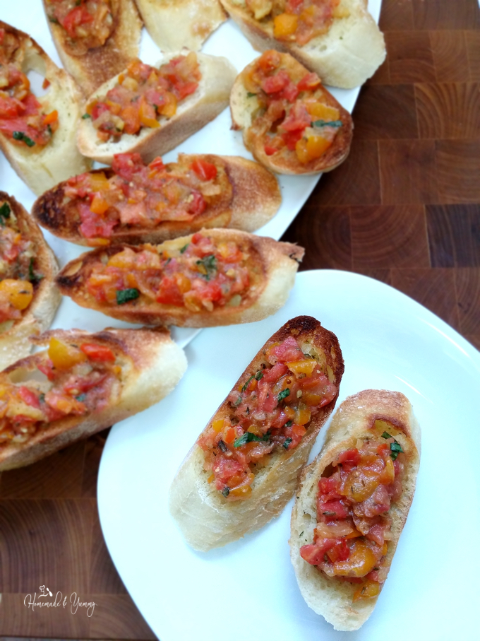 Overhead shot of bread slices topped with bruschetta.