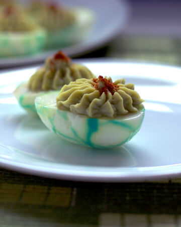 Deviled eggs made with creamy avocado and a bit of mayo, topped with smoked paprika and encased in a green veined shell. The Green Devil will the the hit of the party. | homemadeandyummy.com