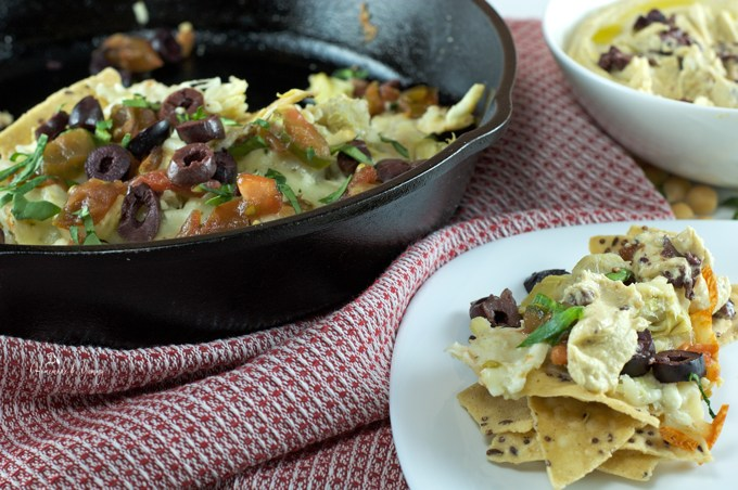 Nachos in a skillet, and on a plate ready to eat.