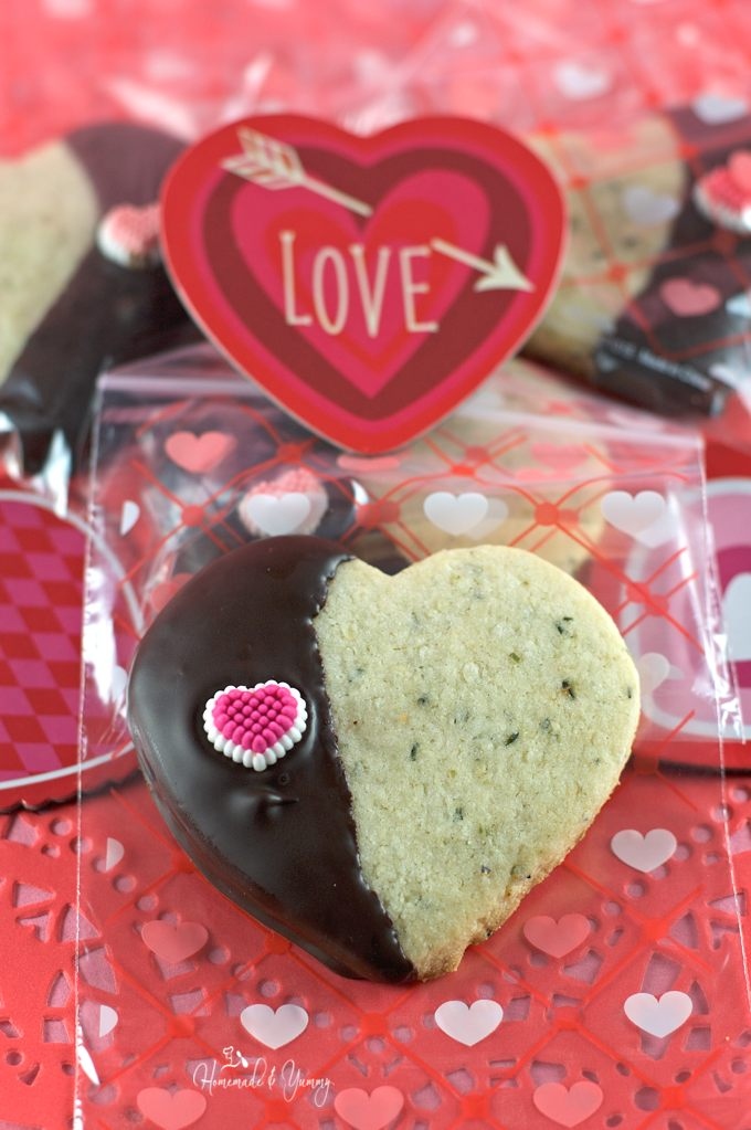 Closeup of Hemp Heart Cookie with Valentine decoration in the background.