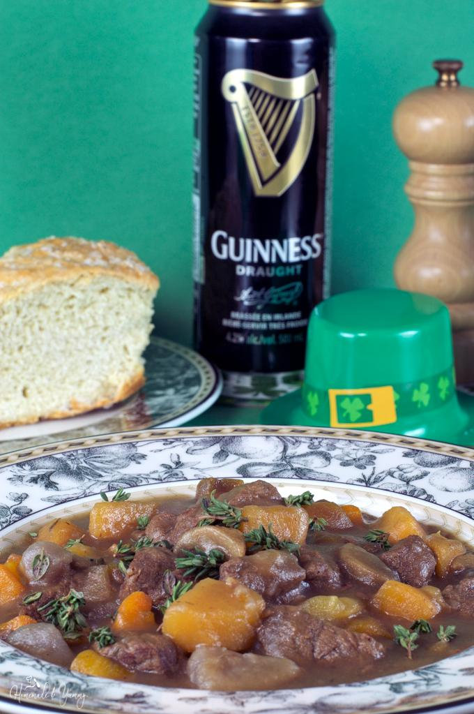 Irish stew in a bowl with a can of Guinness in the background.