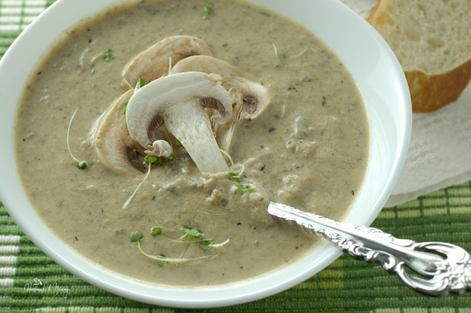Mushroom soup in a bowl with a spoon.