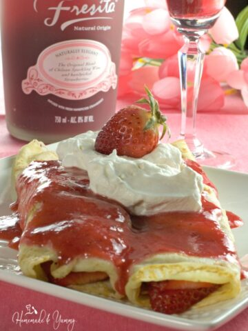 Sparkling Strawberry Crepes are perfect for a weekend brunch. Fresh berries soaked in sparkling wine turn ordinary into extraordinary. Mother's Day treat! |homemadeandyummy.com