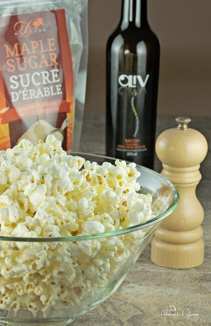 Popcorn in a bowl, with seasonings in the background.