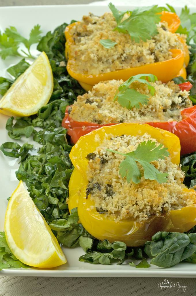 Closeup of quinoa stuffed peppers on a serving plate.