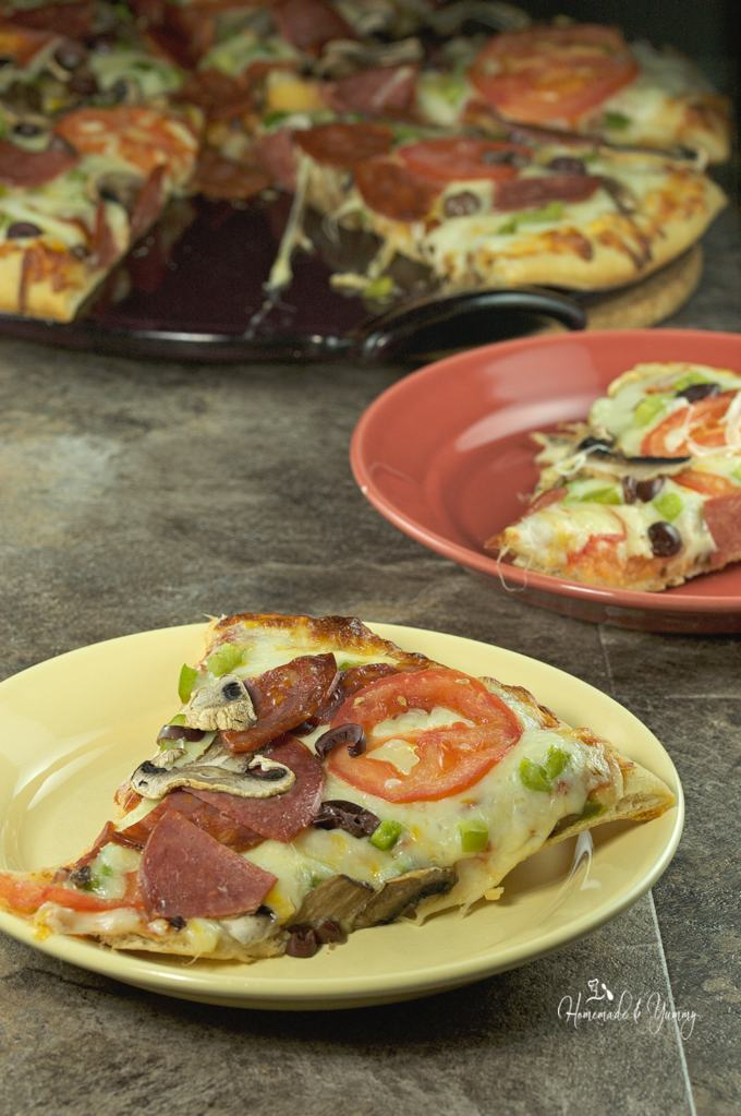 Almost Homemade Pizza is easy to make and so much cheaper than takeout. Customize a store bought cheese pizza, bake and enjoy!! | homemadeandyummy.com