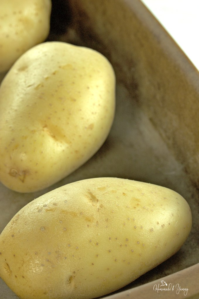 Potatoes in a pan for roasting.