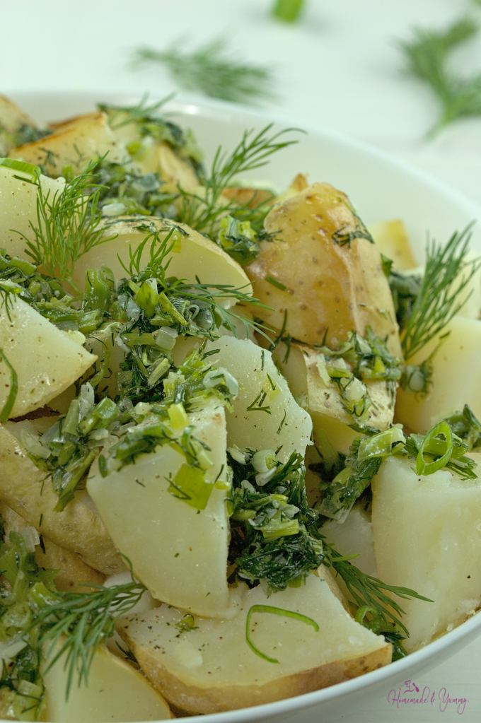 Close up of a bowl of Potatoes with Green Onion & Dill.