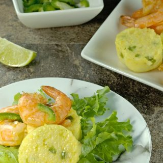 Southwest Shrimp and Grits Salad is a little twist on a classic dish. Grilled cajun shrimp and discs of jalapeño grits on a bed of greens with a touch of smoky flavour. | homemadeandyummy.com