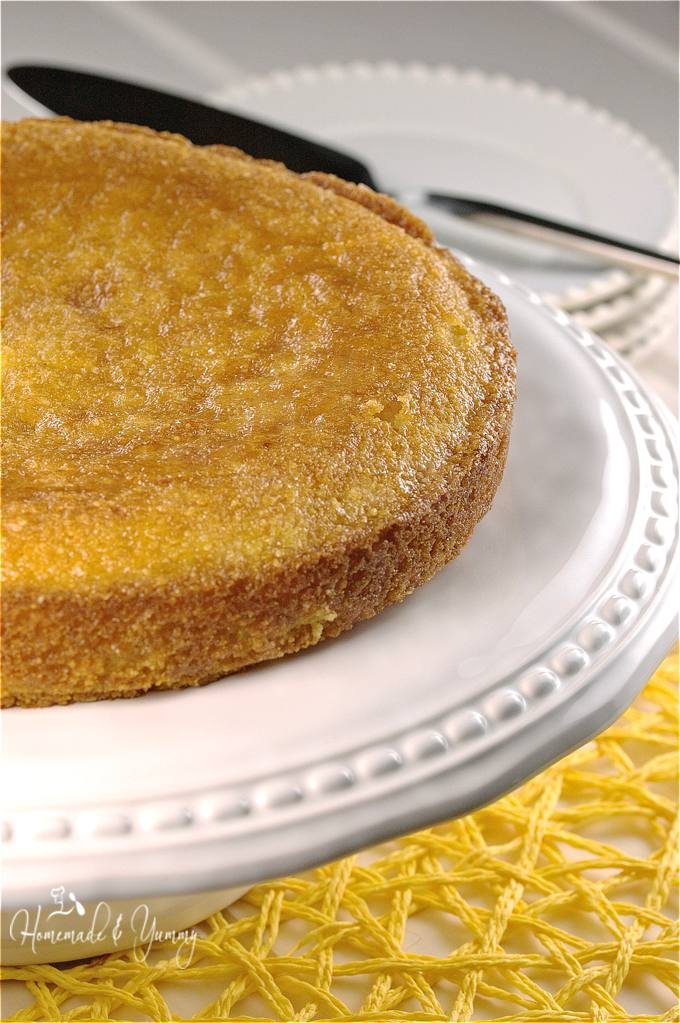 Lemon almond cake on a cake stand.