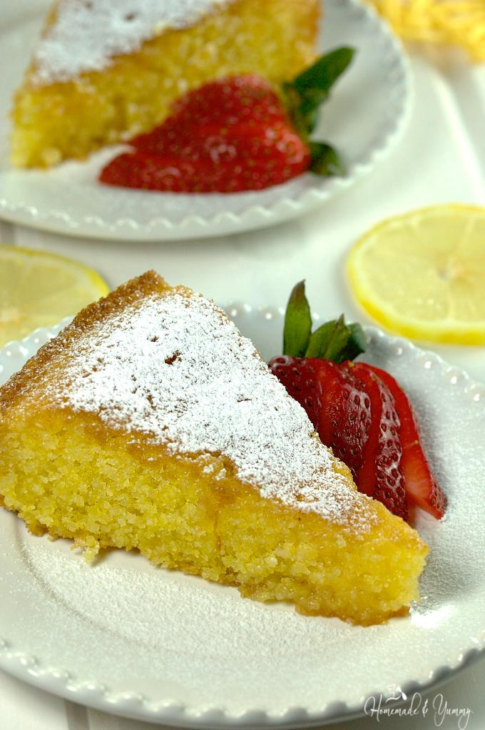 Close up of a slice of Lemon Polenta Cake on a plate.