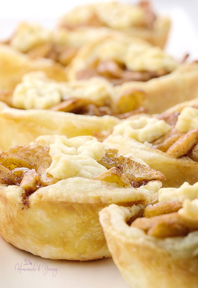 Puff Pastry Fried Apple Tarts are the perfect little treat. Tender slices of apples with just the right amount of sweetness, laced with cinnamon, all in a flaky shell. | homemadeandyummy.com