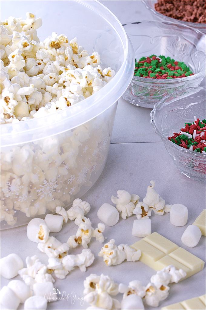 Popcorn in a large bowl, decorating sprinkles in the background.