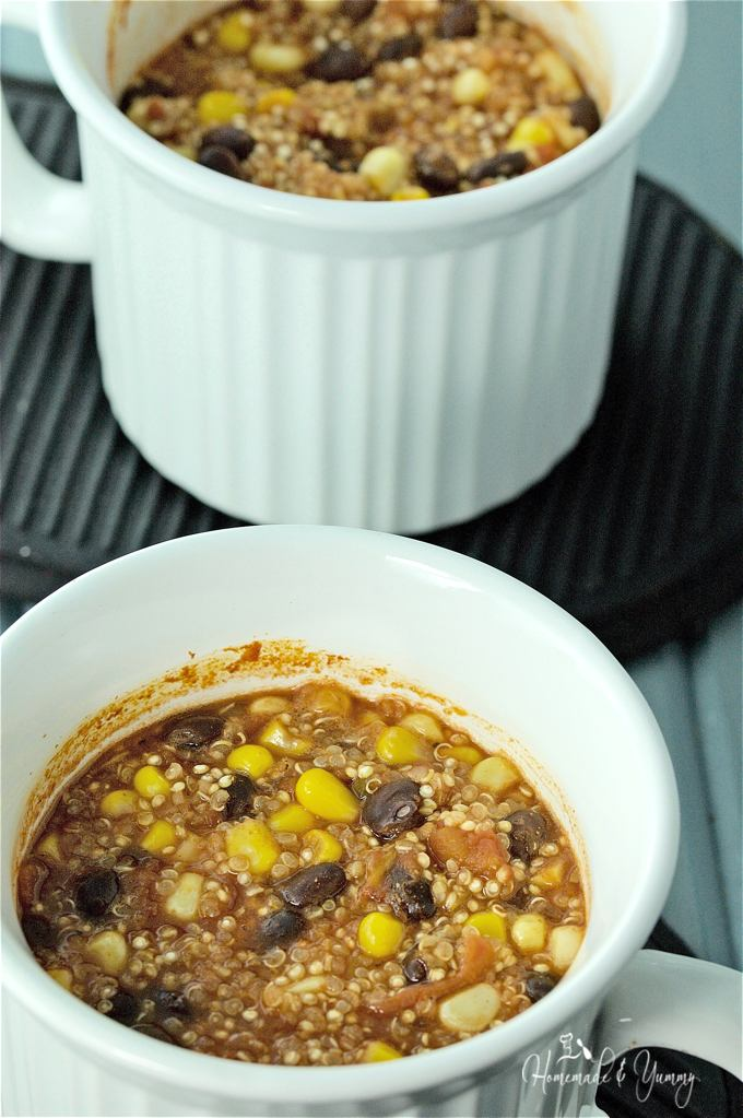 2 mini Mexican casseroles in mugs ready to eat.