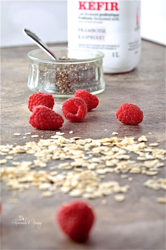 Pancake ingredients, chia seeds, oatmeal, fresh raspberries and some kefir in the background.