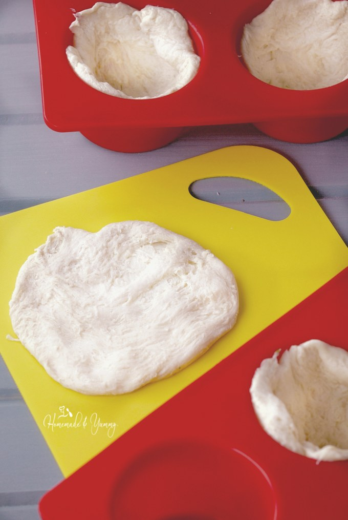Dough being formed and placed into the silicone muffin pans.