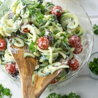 Creamy Goat Cheese Greek Zoodle Salad is fun to make. Bursting with Mediterranean flavours. Makes the perfect side to any meal, especially in grilling season. | homemadeandyummy.com