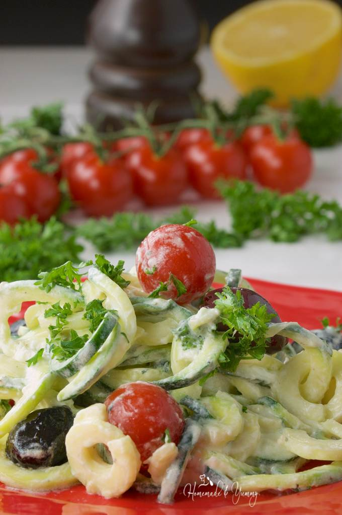 Close up shot of zoodle salad served onto a plate ready to eat.