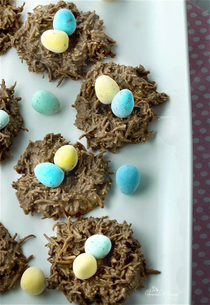 Overhead shot of chocolate nest on a plate with candy Easter eggs on top of each one.
