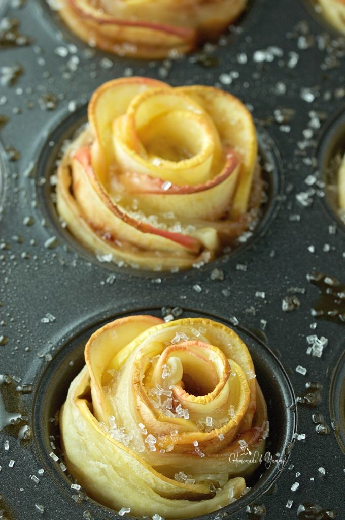 Overhead close up of the roses right out of the oven sprinkled with sugar.