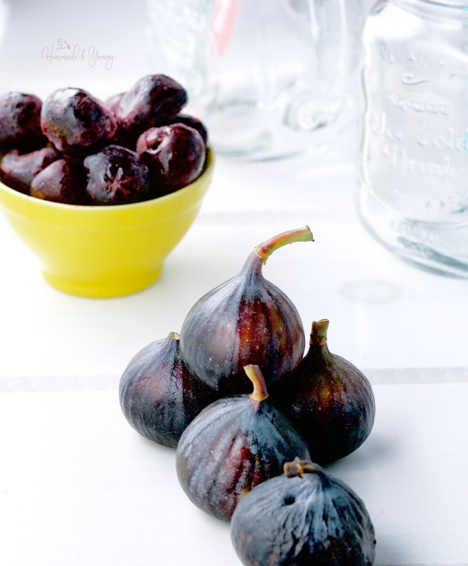 Fresh figs and a bowl of frozen cherries.