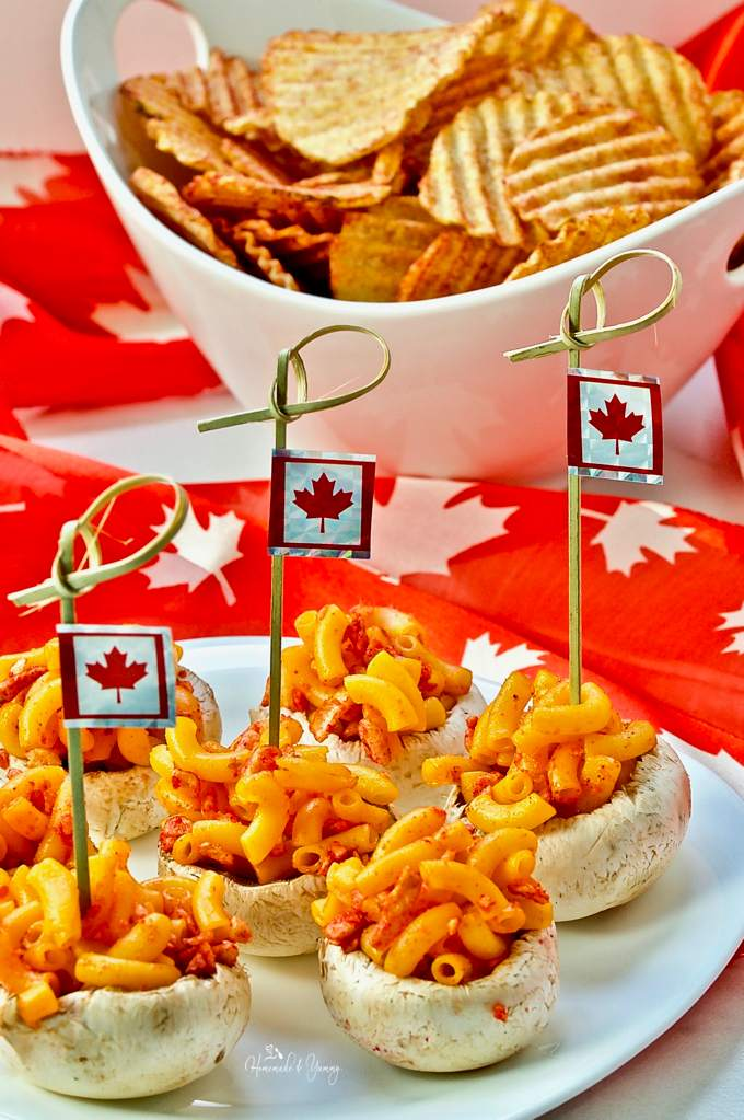 Canadian Inspired Mushroom Bites Celebrating #Canada150 on a plate with Canadian flags.