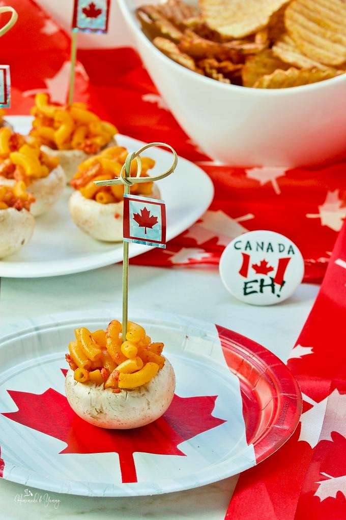 Mushrooms stuffed with macaroni with Canadian flag topper decoration.
