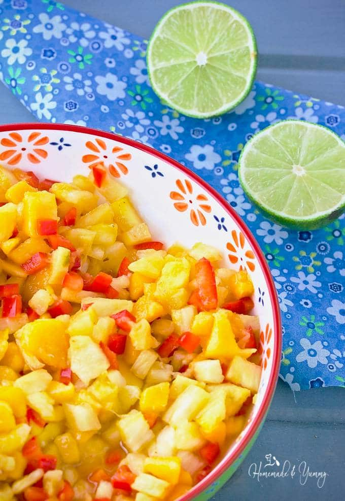 Fresh Pineapple Mango Tropical Salsa with Rum is perfect for summer. Fresh fruit with a splash of rum, combine to make the perfect side for grilled meats and fish. |homemadeandyummy.com