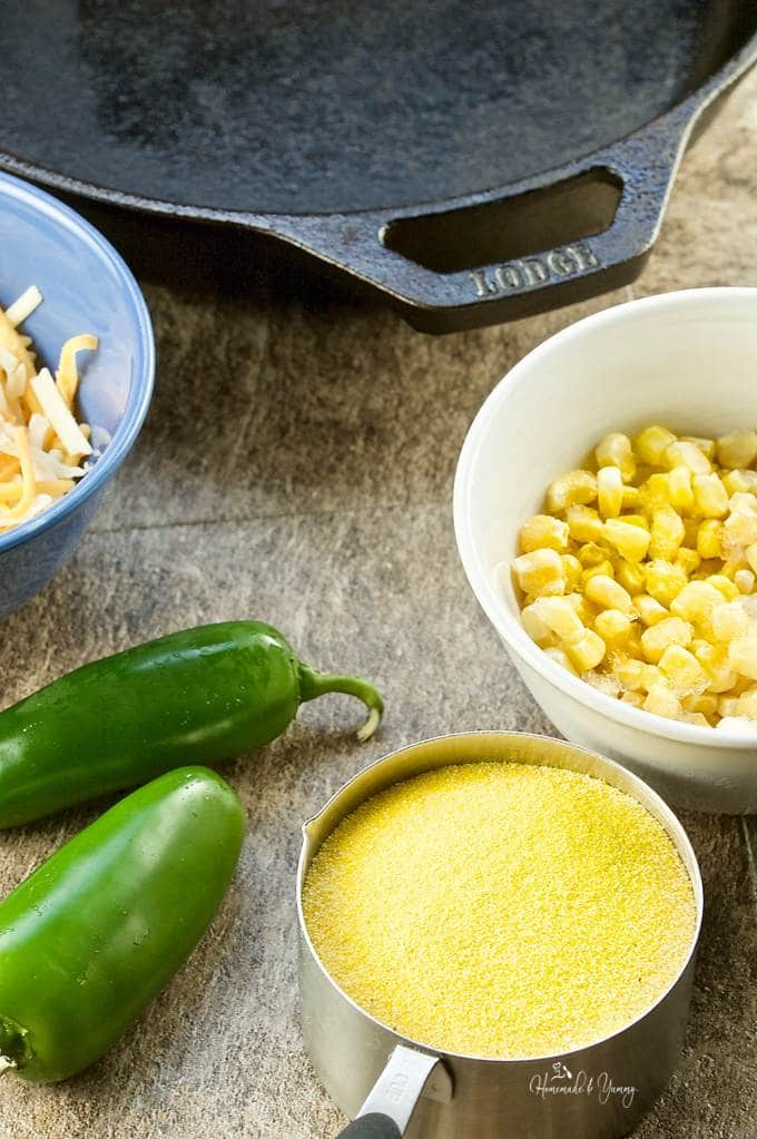 Recipe ingredients, cornmeal, corn, cheese and jalapeno peppers.