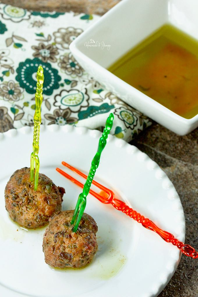 Easy Olive Tapenade Cocktail Party Meatballs on an appetizer plate