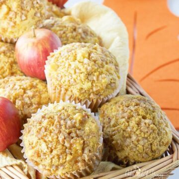 A basket full of Fresh Apple Muffins.