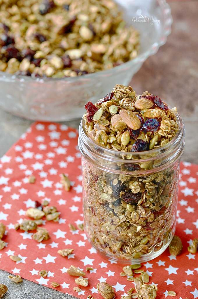 Home for the Holidays Festive Crunchy Granola in a glass jar ready for gift giving.