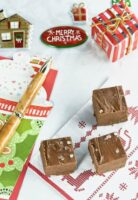 Overhead shot of 3 pieces of fudge on a Christmas napkin.