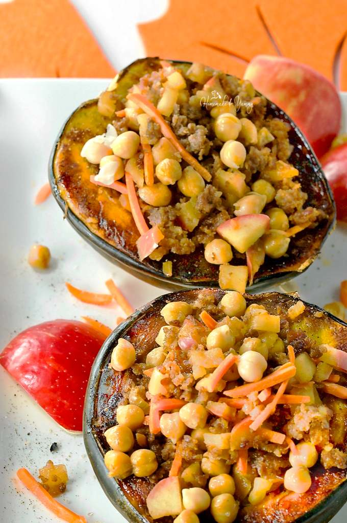 2 baked and stuffed squash halves on a plate.