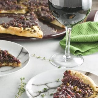 Pissaladiere French Pizza with Onion Olive Tapenade. Caramelized onions, olive tapenade, capers and fresh thyme. Simple ingredients, sensational flavour. #sponsored #frenchpizza #pissaladiere #olivetapenade #homemadeandyummy | homemadeandyummy.com