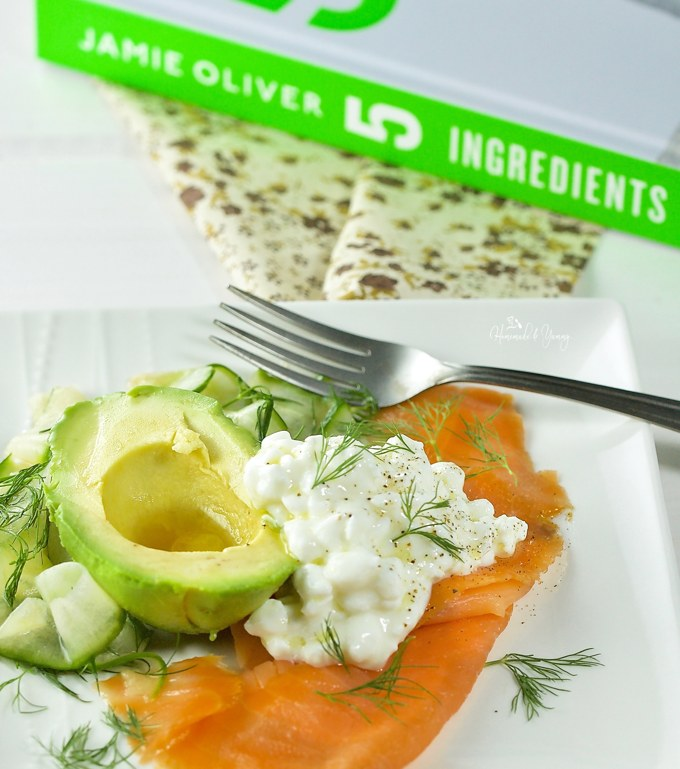 Quick and Easy Smoked Salmon Plate on a plate in front of the cookbook.