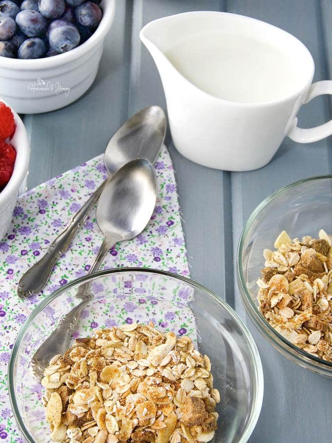 Mmuesli mix portioned out in serving bowls.