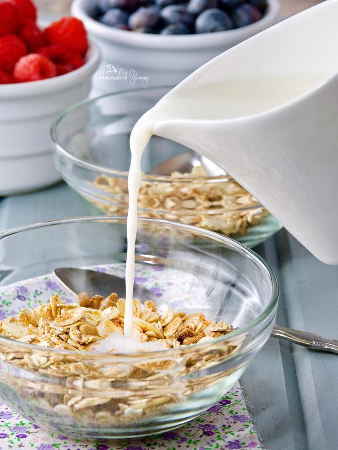 Easy Muesli in a bowl getting milk poured on it.