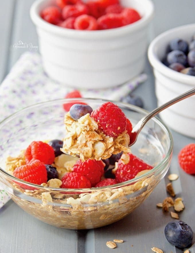 Easy muesli in a bowl. scooped onto a spoon ready to eat.