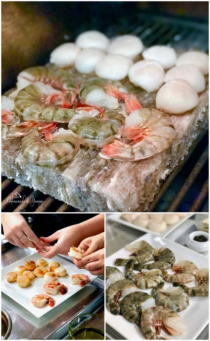Grilling seafood namely shrimp and scallops on a salt stone
