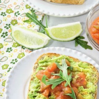 Smashed Avocado on Toast Topped with Salsa ready to eat.
