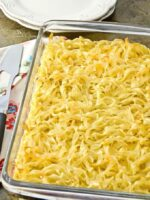 Egg noodle casserole right out of the oven, ready to cut and serve.