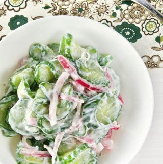 Overhead shot of Cucumber Salad with Pickled Onions in a bowl.