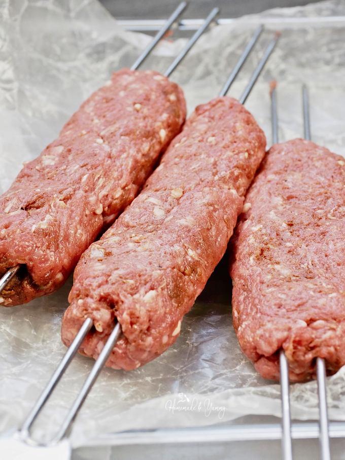 Lamb Kofta Kebabs on a tray ready for the grill.