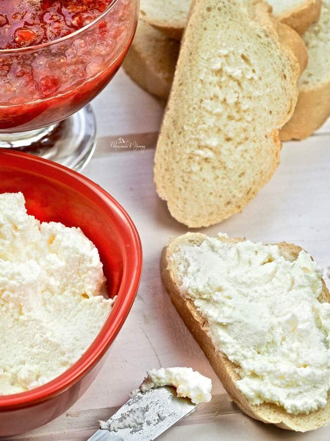 Bread slices topped with ricotta cheese.