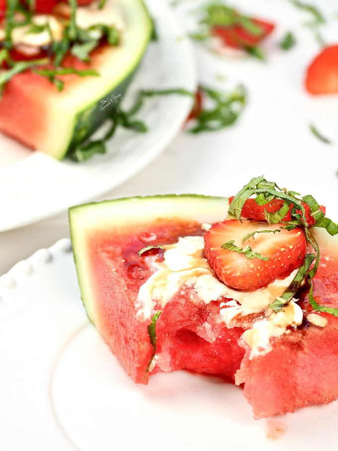 Watermelon Fruit Pizza on a plate, with a bite taken out of it.