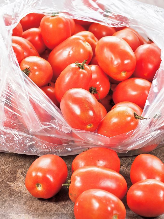 A bag of fresh Roma tomatoes.
