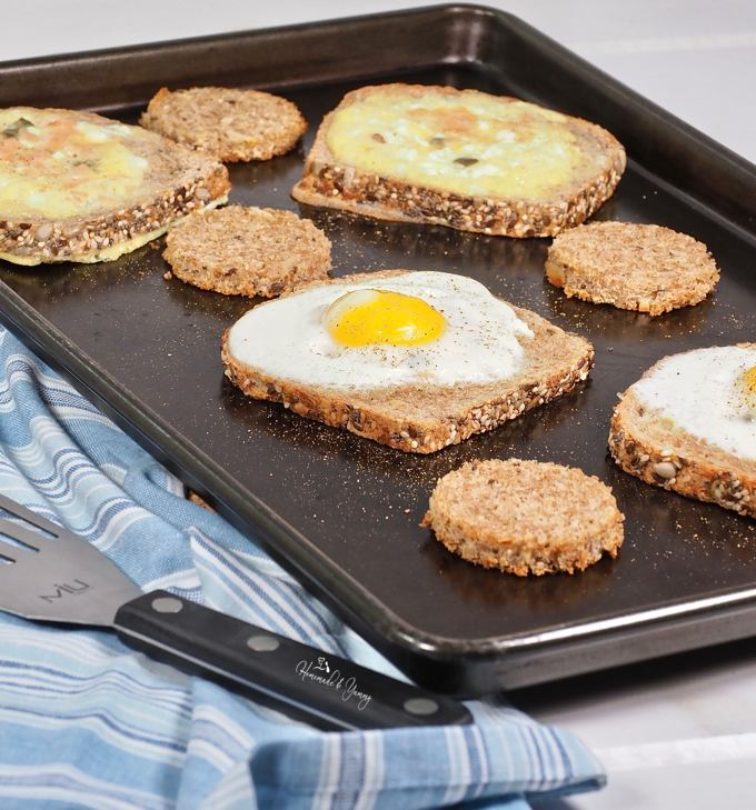 A sheet pan full of Eggs In A Hole ready to eat.