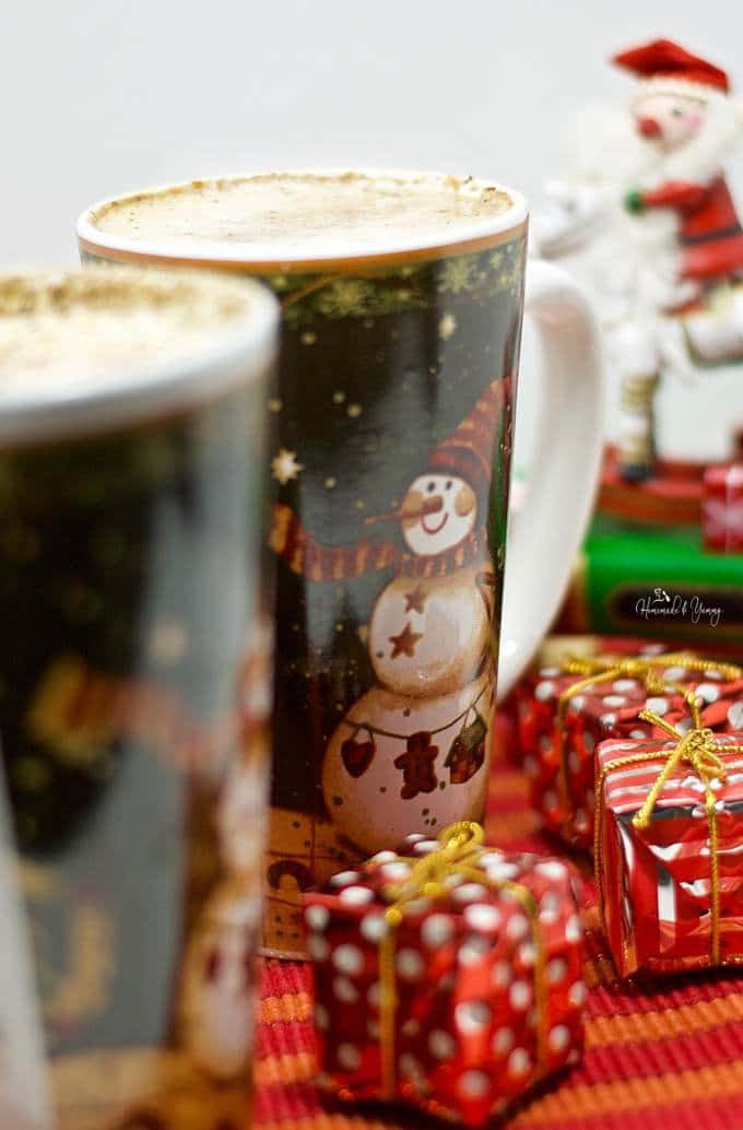 Closeup shot of 2 Rum & Eggnog Lattes in Christmas mugs